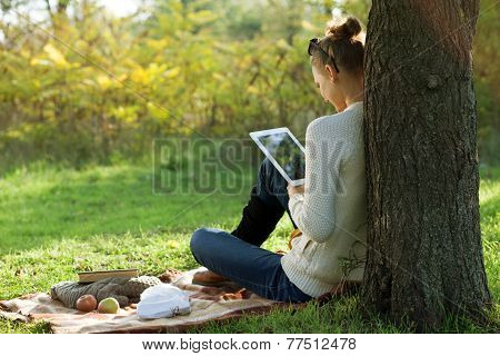 Distance Education. Sitting Woman Using Ipad During Stroll Outdoors