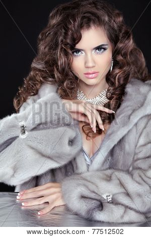 Beautiful Fashion Brunette Girl In Mink Fur Coat Isolated On Black Background. Fashion Beauty Woman