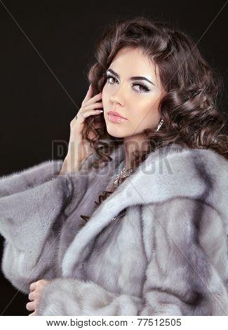 Beautiful Brunette Woman In Mink Fur Coat Isolated On Black Background. Fashion Beauty Girl Model