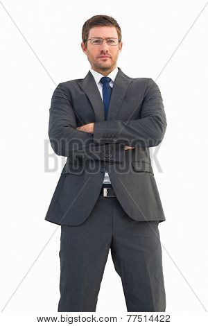 Frowning businessman looking at camera on white background