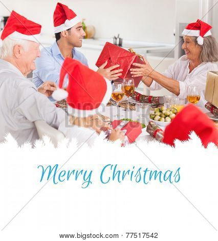 Happy family exchanging christmas gifts against merry christmas