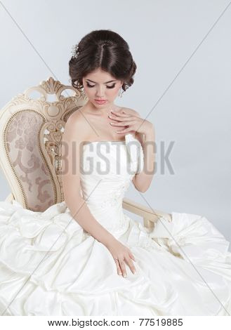 Beautiful Brunette Bride Wearing a Modern Wedding Dress With Voluminous Skirt