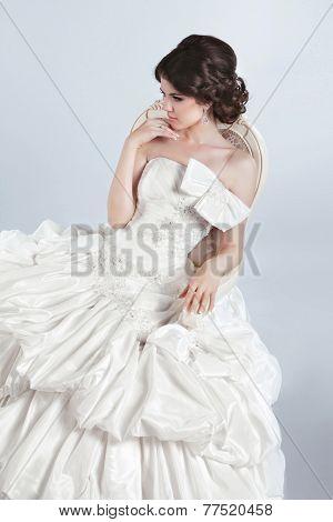 Beautiful Bride Model Woman Wearing a Wedding Dress With Voluminous Skirt, Studio Photo