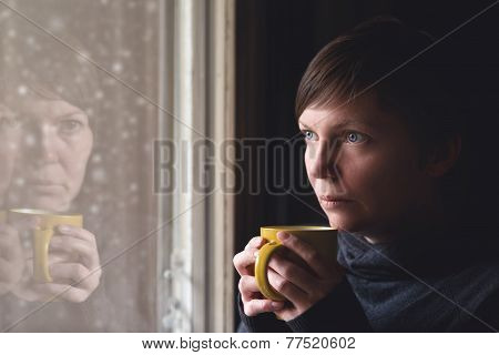 Sad Alone Woman Drinking Coffee In Dark Room
