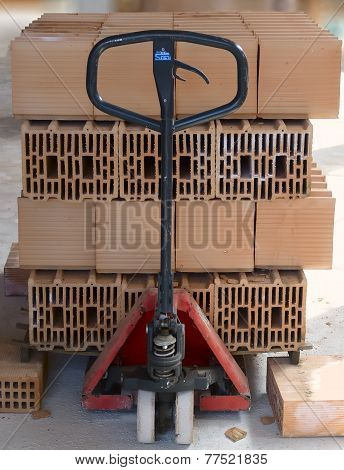 Hand pallet truck with bricks poroton