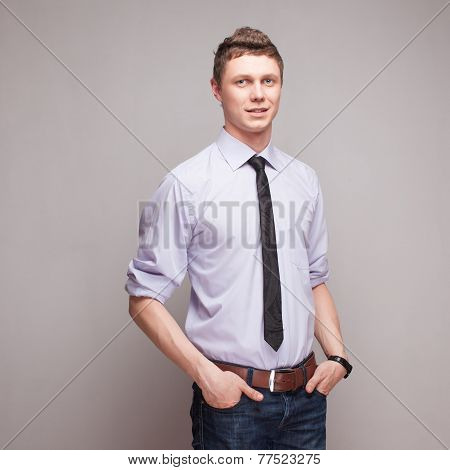 Square Portrait Of Cheerful Young Man In Blue Shirt With Tie And Jeans
