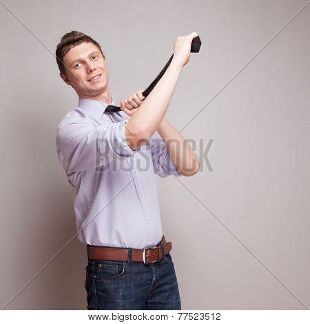 Businessman Tightens A Tie
