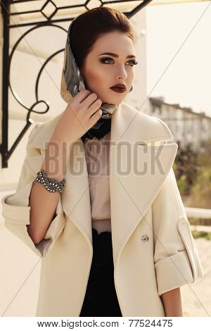 Beautiful Elegant Brunette In Luxurious Beige Coat And Scarf