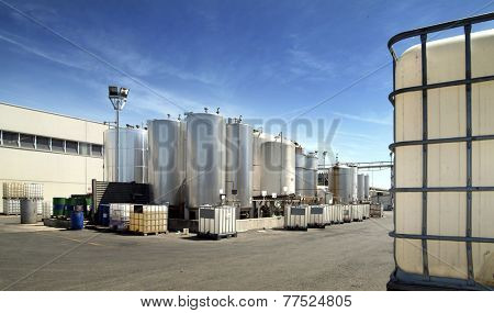 exterior of a chemistry factory with tanks and pipes