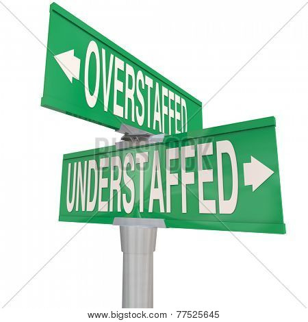 Understaffed and Overstaffed words on two way street or road signs to illustrate staffing level management at a business, company or organization