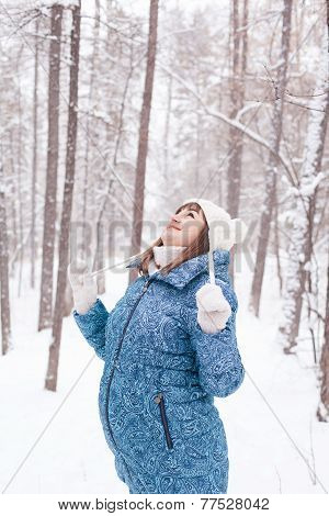 Pregnant Woman In Winter Forest