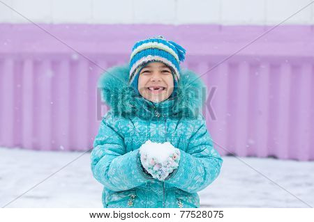 Happy Kid Girl Child Outdoors In Winter Playing Holding Snow