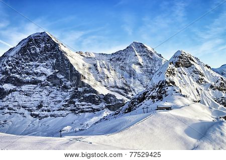 Swiss Alpine Peaks And Ski Slopes In Winter