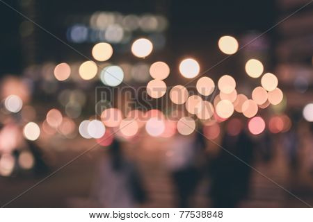 Abstract urban background with blurred buildings and street, shallow depth of focus.