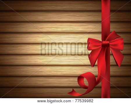 Red Silky Bow and Ribbon over Wooden Background - EPS 10