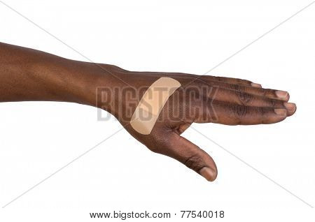 Hand with adhesive bandage isolated on white background