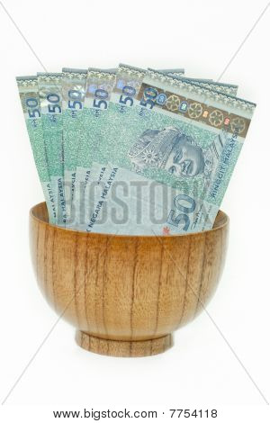 Malaysian Ringgit In A Wooden Bowl