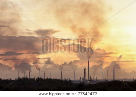 Oil refinery at Curacao polluting the air at sunrise
