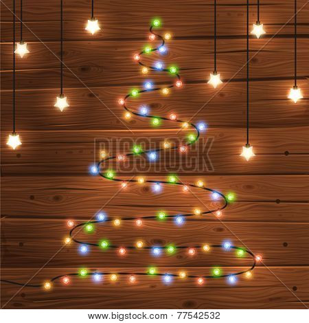 Glowing Christmas Lights in the form of a Christmas tree for Xmas Holiday Greeting Cards Design. Wooden Hand Drawn Background.