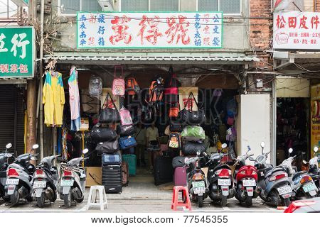 TAIPEI, TAIWAN - November 16th : A Shop sell various bags near Longshan Temple, Taipei, Taiwan on November 16th, 2014.