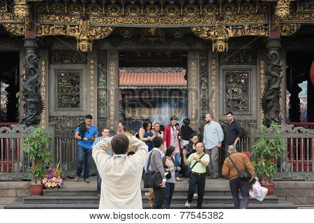 TAIPEI, TAIWAN - November 16th : The believer worship hands held high in Longshan Temple , Taiwan on November 16th, 2014.