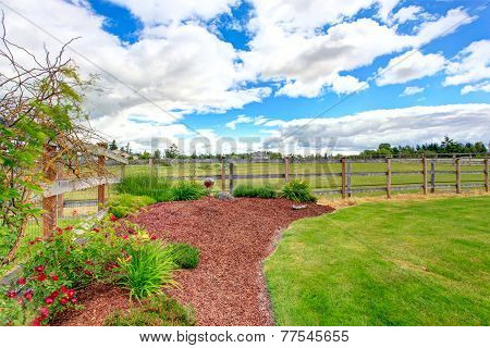 Farm House Front Yard Landscape With Sawdust Flower Bed