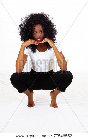 Attractive Skinny African American Teen Girl Squatting