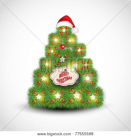 Shiny beautiful X-mas Tree decorated by mistletoe, Santa cap and tag of Merry Christmas on shiny grey background.