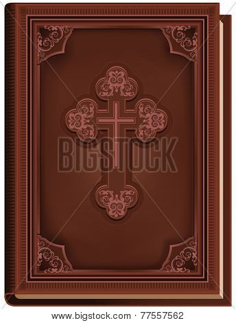 The Bible. Closed book with a cross on the cover