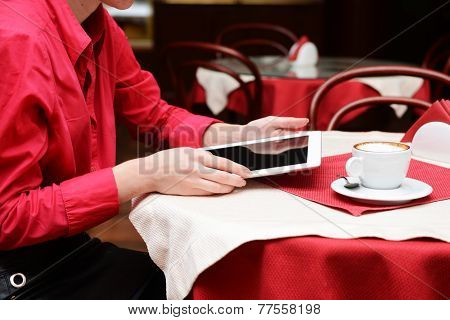 Woman with tablet computer in cafe shop