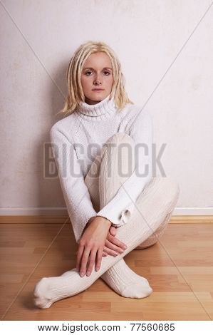 woman wearing turtleneck sweater and overknee socks