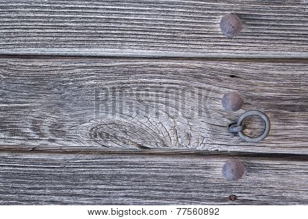 Old run-down wooden door and doorknocker