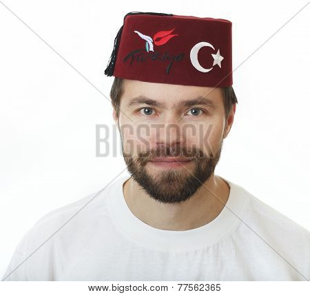 Man with a beard in the fez.