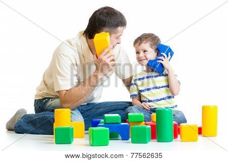 father and kid boy role-playing together
