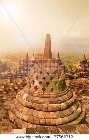 Beautiful ancient monument of Borobudur Buddhist temple at sunrise,  Yogyakarta, Java Indonesia.