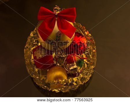 Christmas shiny colored decorations in a glass bowl