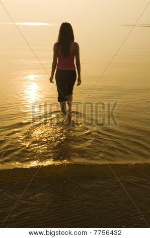 Silhouette Asian Girl Walking On A Beach
