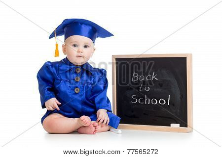 funny baby in graduation clothes at chalkboard