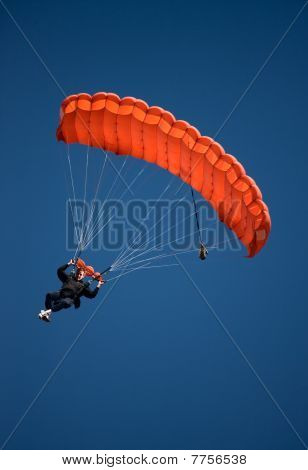 Red Parachute Against Blue Sky