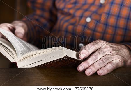 Old Man Hands Holding A Book