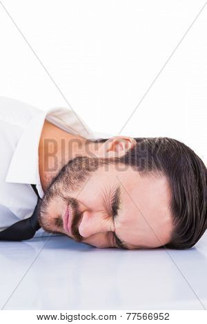 Businessman banging his head on white background