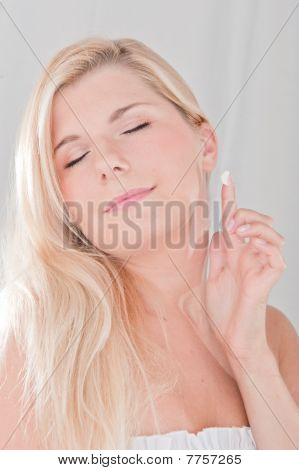 young beautiful woman touching her healthy pure skin