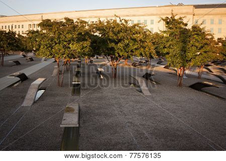 ARLINGTON, VA - SEPT 13, 2014: Lines of granite and stainless steel memorial units facing the Pentagon. The cantilevered benches have pools of water and name of each victim of the 2001 attack.
