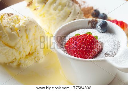 Ice Cream Serv With Hot Chocolate Topping Stawberry And Blueberry