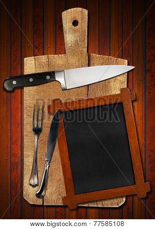 Empty Blackboard On Wooden Cutting Board