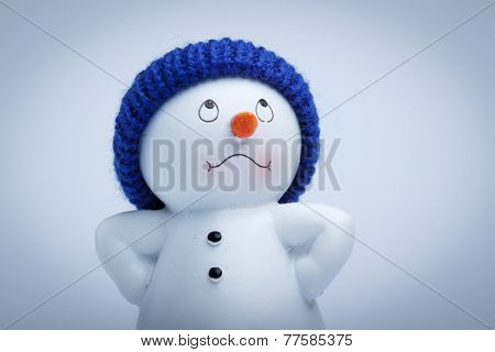 Cheerful snowman on a white snowy background.