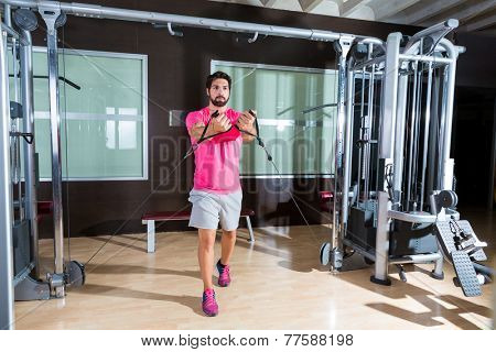 Standing low cable crossover fly pulley flies man workout at gym