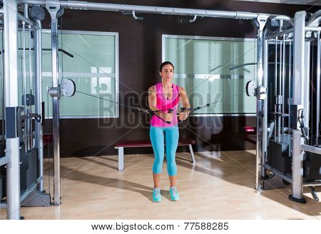 Standing cable crossover fly pulley flies woman workout at gym