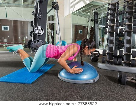 Bosu knees push up push-up woman at gym workout exercise