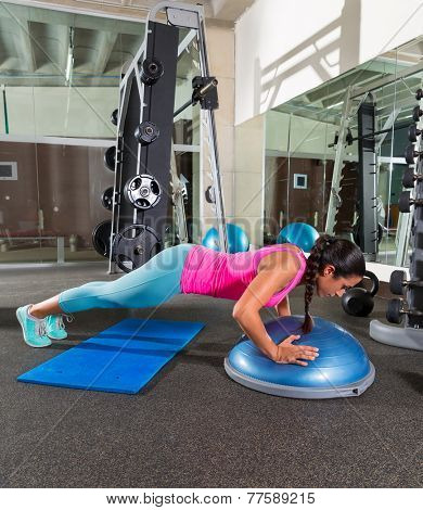 Bosu push up push-up woman at gym workout exercise